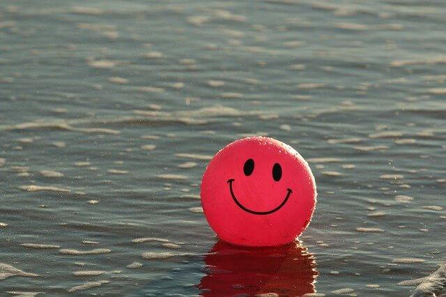 Sourire ballon satisfaction client